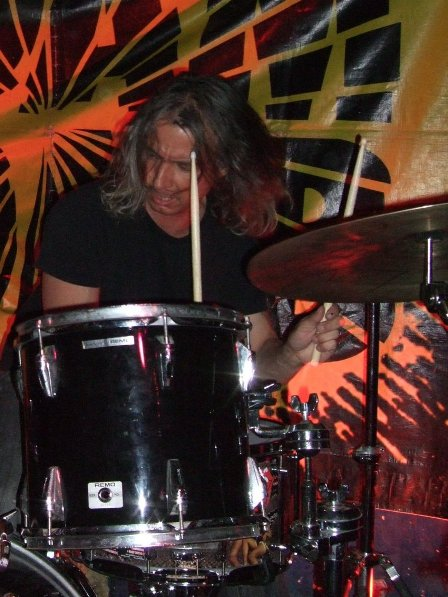 Bobby Reynolds playing drums with Adam Bomb in Paris