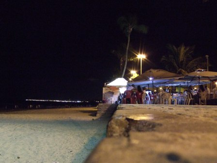 The beach and bars in Itapua by night, Brazil