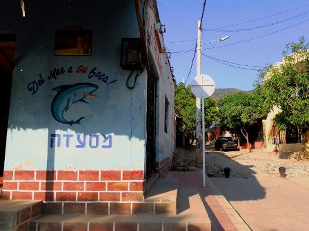The sign of a restaurant written in Hebrew in Taganga in Colombia