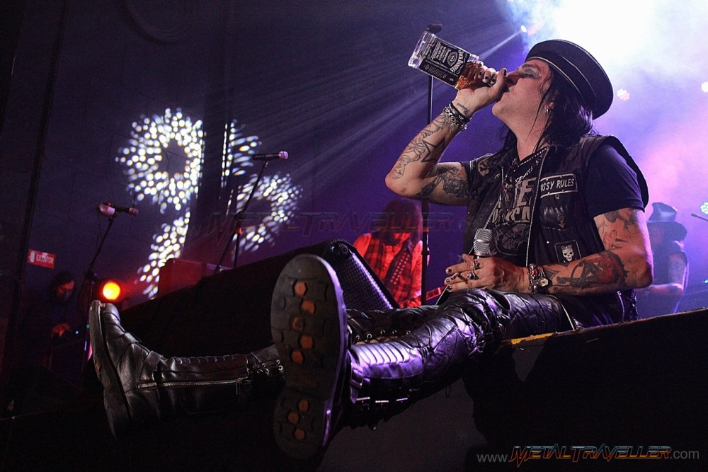 Taime Downe from Faster Pussycat drinking Jack Daniels