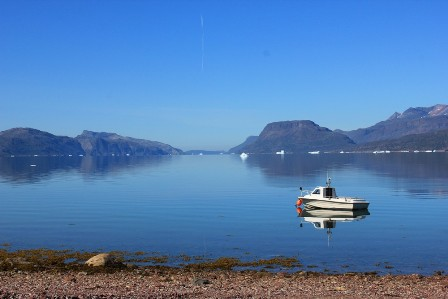 The majestic Tunulliarfik Fjord with a lonely boat, Greenland