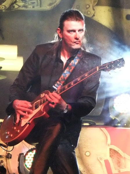 Michael Weikath playing guitar with Helloween
