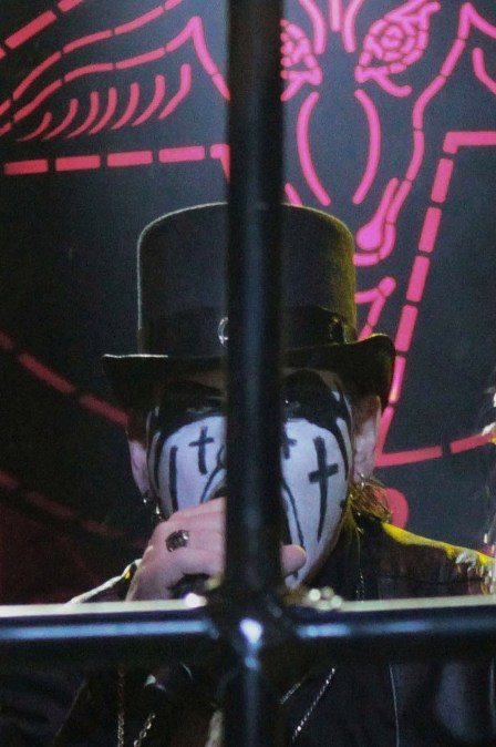King Diamond behind an inverted cross