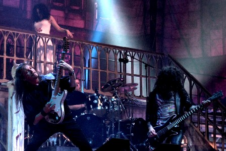 Mike Wead, Hal Patino and Jodi Cachia performing on stage with King Diamond