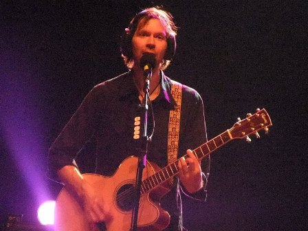 Wild World, To Be with You... Paul Gilbert playing an acoustic guitar