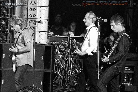 Rick Parfitt, Francis Rossi and Rhino Edwards from Status Quo on stage in Clisson