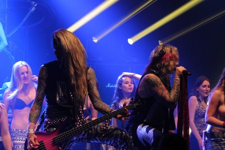 The girls on stage with Steel Panther in Paris