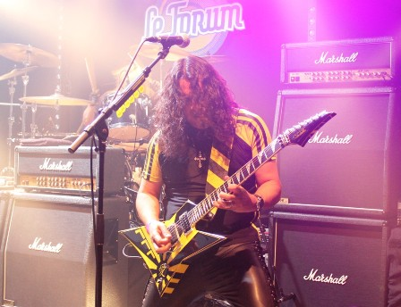 Oz Fox on guitars playing with Stryper in France