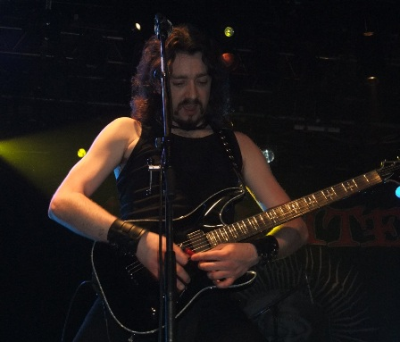 Matt McGuire playing slide guitar with a lighter - The Exploited live in Paris