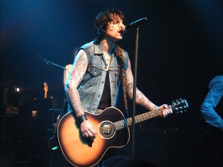 Ricky Warwick, the new Thin Lizzy frontman, on acoustic guitar