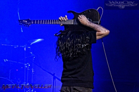 Pablo García playing guitar on his back - live with Warcry